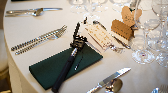 table set up and selfie sticks for wedding guests
