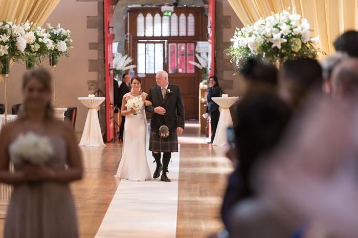 father and daughter walking down the aisle - image by Julie Tinton Photography