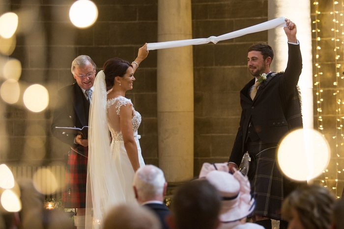 tying the knot at Mansfield Traquair Edinburgh - image by Julie Tinton Photography