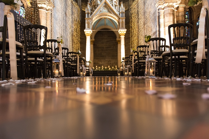 wedding ceremony under soaring ceilings of Mansfield Traquair dressed beautifully with fairy lights - image by Julie Tinton Photography