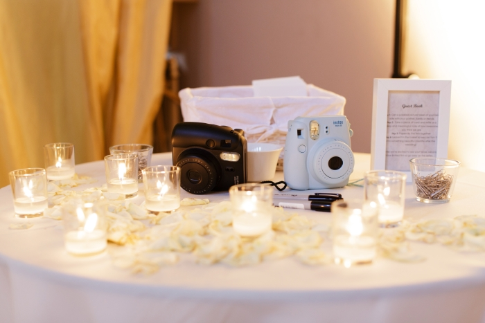 Wedding guest book created with polaroid photos - photo credit Blue Sky Photography