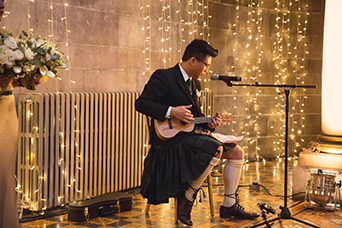 Bride's brother performign during the ceremony at Mansfield Traquair in Edinburgh. Photo credit: Kirsty Stroma Photography