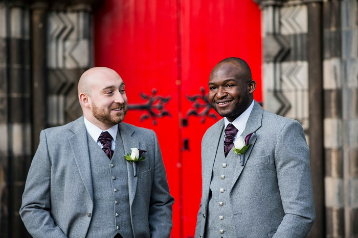 A groom and best man wait outside Mansfield Tranquair, Edinburgh for the wedding to start