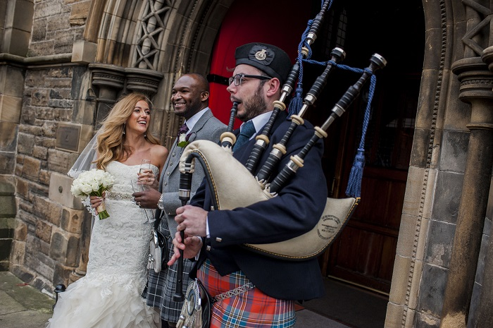 A happy bride and groom outside Mansfield Tranquair, Edinburgh