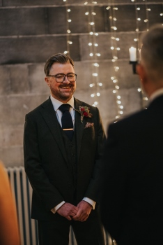 The groom smiling during the exchange of vows in Mansfield Tranquair, Edinburgh